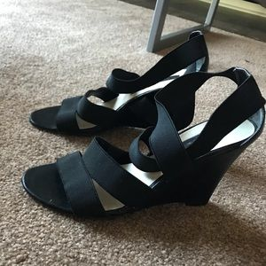 Black high heels, crosses on top